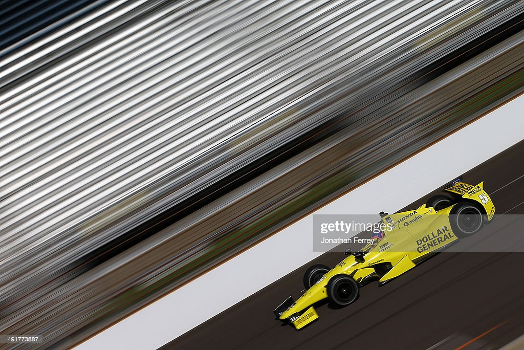 Jacques Villeneuve of Canada, drives his #5 Dollar General Schmidt Peterson Motorsports Honda Dallara during practice for the 98th Indianapolis 500 Mile Race on May 17, 2014 at the Indianapolis Motor Speedway in Indianapolis, Indiana.
