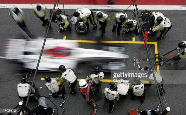 Jacques Villeneuve of Canada practices pit stops