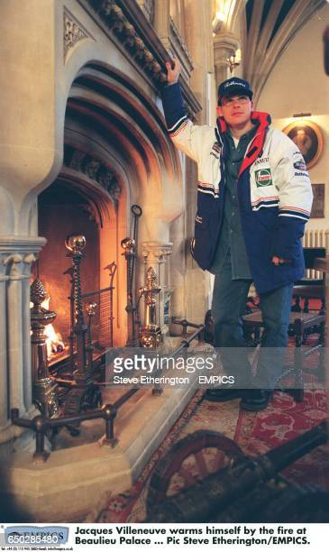 Jacques Villeneuve warms himself by the fire at Beaulieu Palace