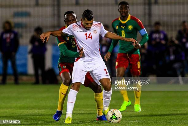 Jacques Zoua of Cameroon in action against Mohamed Amine Ben Amor of Tunisia during the friendly football match between Tunisia and Cameroon at the...