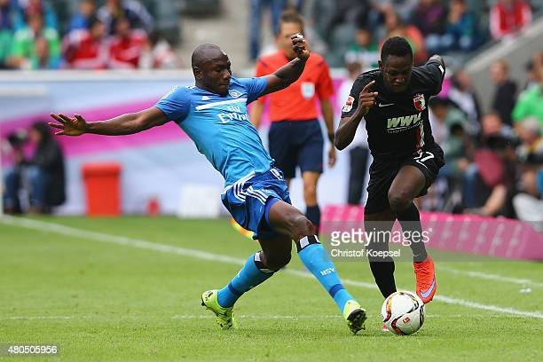 Jacques Zoua of Hamburg challenges Abdul Rahman Baba during the Telekom Cup 2015 final match between Hambruger SV and FC Augsburg at BorussiaPark on...