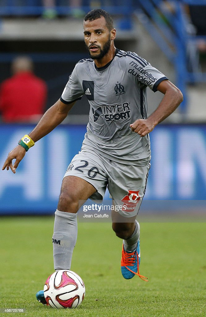 Jacques-Alaixys Romao of OM in action during the French Ligue 1 match between Stade Malherbe de Caen and Olympique de Marseille at Stade Michel D'Ornano on October 4, 2014 in Caen, France.