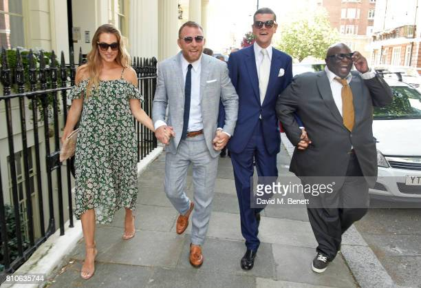 Jacqui Ainsley Guy Ritchie Alexander SpencerChurchill and Ade attend Piers Adam and Sophie Vanacore's wedding at St John's Church on July 7 2017 in...