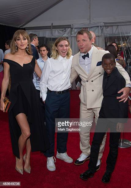 Jacqui Ainsley Rocco Ritchie Guy Ritchie and David Ciccone Ritchie attend 'The Man From UNCLE' New York Premiere at the Ziegfeld Theater on August 10...