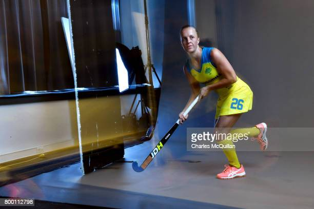Jacqui Day of Australia runs across a studio floor during a player portrait photo session for FINTRO Hockey World League on June 23 2017 in Brussels...