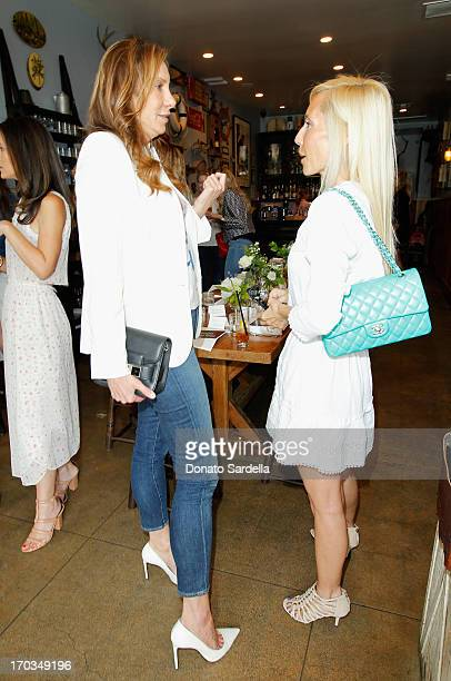 Jacqui Getty and designer Alexandra Von Furstenberg attend the Paper Denim Cloth and Baby2Baby Luncheon at Son Of A Gun on June 11 2013 in Los...