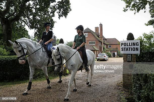 Jacqui Vaughan and Sophie Allison riding horses Splash and Sharna ride out of the driveway of a private residence used as a polling station near...