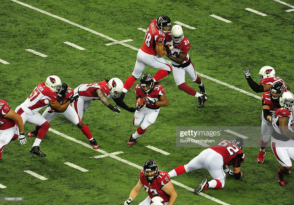 Jacquizz Rodgers #32 of the Atlanta Falcons carries the ball against the Arizona Cardinals at the Georgia Dome on November 18, 2012 in Atlanta, Georgia