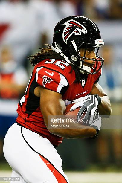 Jacquizz Rodgers of the Atlanta Falcons carries the ball against the New England Patriots in the first quarter of the game at Georgia Dome on...