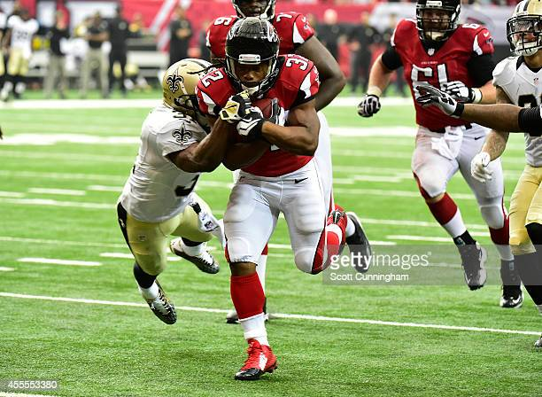 Jacquizz Rodgers of the Atlanta Falcons carries the ball for a 4th quarter touchdown against the New Orleans Saints at the Georgia Dome on September...