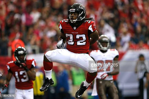 Jacquizz Rodgers of the Atlanta Falcons reacts after scoring a touchdown against the Tampa Bay Buccaneers at Georgia Dome on October 20 2013 in...