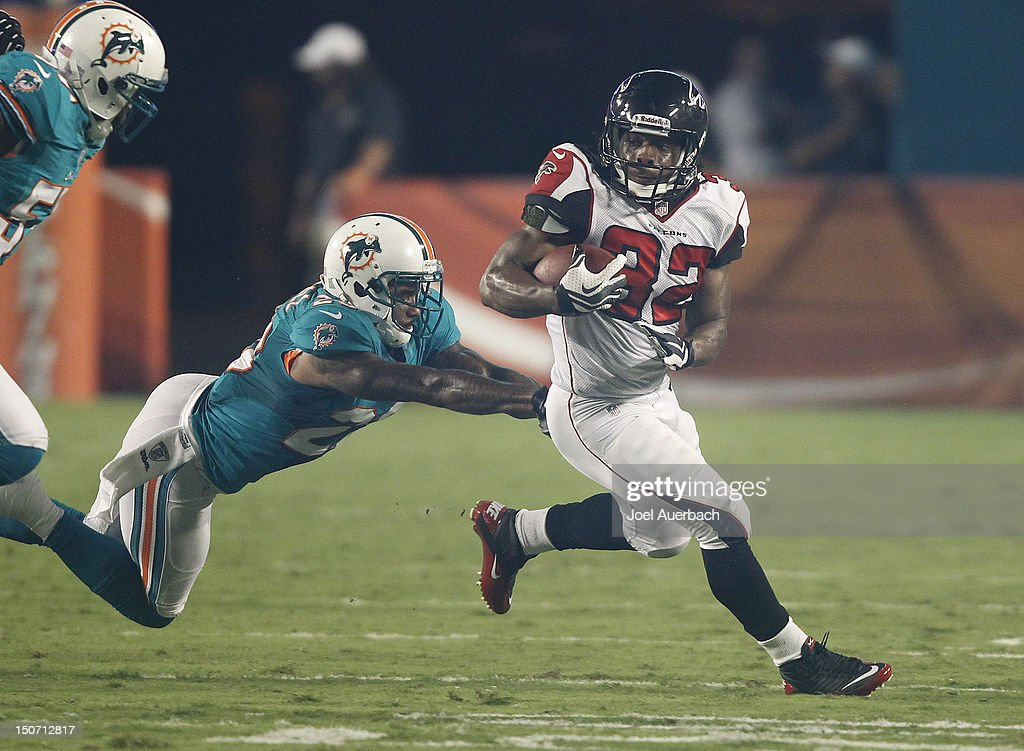 Jacquizz Rodgers #32 of the Atlanta Falcons runs with the ball past <a gi-track='captionPersonalityLinkClicked' href=/galleries/search?phrase=Nolan+Carroll&family=editorial&specificpeople=5574471 ng-click='$event.stopPropagation()'>Nolan Carroll</a> #28 of the Miami Dolphins during a preseason game on August 24, 2012 at Sun Life Stadium in Miami Gardens, Florida. The Falcons defeated the Dolphins 23-6.