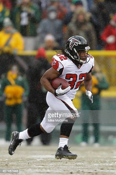 Jacquizz Rodgers of the Atlanta Falcons runs with the football during a kick return against the Green Bay Packers at Lambeau Field on December 08...