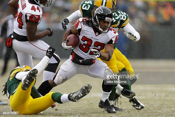 Jacquizz Rodgers of the Atlanta Falcons runs with the football on a kick return during the second half against the Green Bay Packers at Lambeau Field...