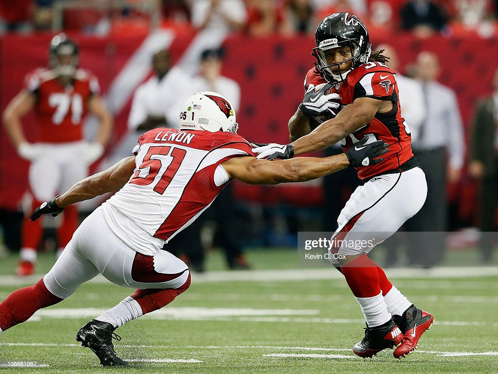 Jacquizz Rodgers #32 of the Atlanta Falcons tries to break a tackle by <a gi-track='captionPersonalityLinkClicked' href=/galleries/search?phrase=Paris+Lenon&family=editorial&specificpeople=2111080 ng-click='$event.stopPropagation()'>Paris Lenon</a> #51 of the Arizona Cardinals at Georgia Dome on November 18, 2012 in Atlanta, Georgia.