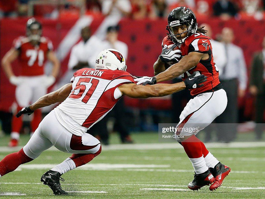 Jacquizz Rodgers #32 of the Atlanta Falcons tries to break a tackle by Paris Lenon #51 of the Arizona Cardinals at Georgia Dome on November 18, 2012 in Atlanta, Georgia.