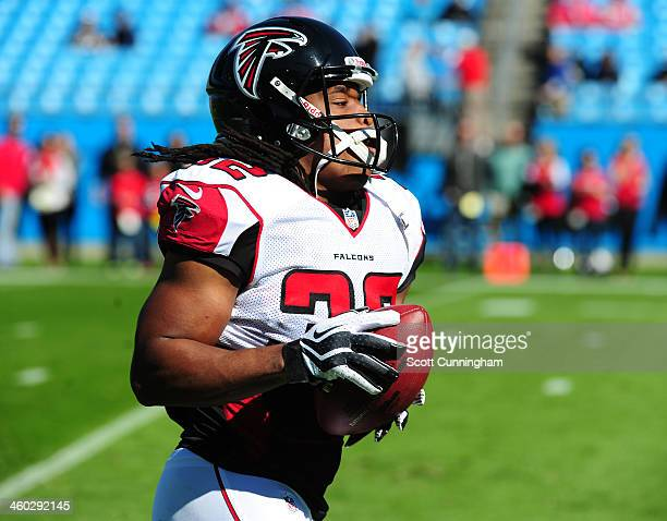 Jacquizz Rodgers of the Atlanta Falcons warms up before the game against the Carolina Panthers at Bank of America Stadium on November 3 2013 in...
