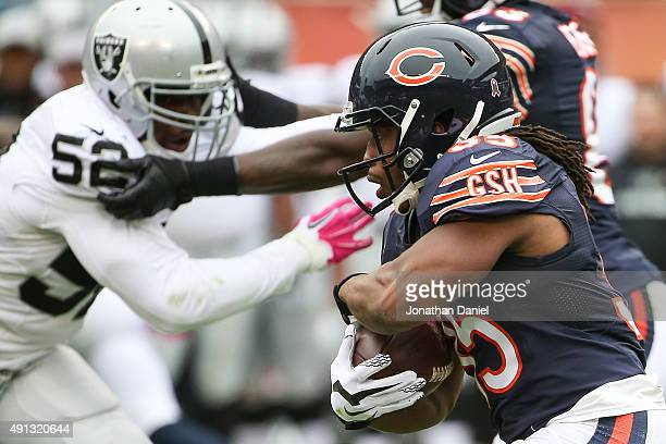 Jacquizz Rodgers of the Chicago Bears carries the football against the Oakland Raiders in the first half at Soldier Field on October 4 2015 in...