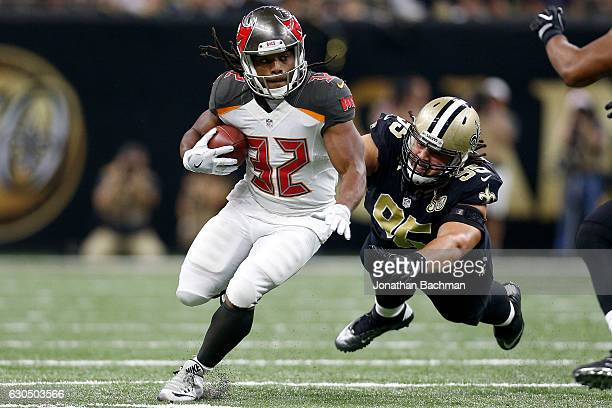 Jacquizz Rodgers of the Tampa Bay Buccaneers avoids a tackle by Tyeler Davison of the New Orleans Saints at the MercedesBenz Superdome on December 24...