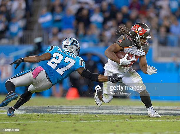 Jacquizz Rodgers of the Tampa Bay Buccaneers breaks away from Robert McClain of the Carolina Panthers during the game at Bank of America Stadium on...