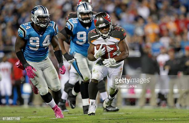 Jacquizz Rodgers of the Tampa Bay Buccaneers runs the ball against the Carolina Panthers in the 2nd quarter during their game at Bank of America...