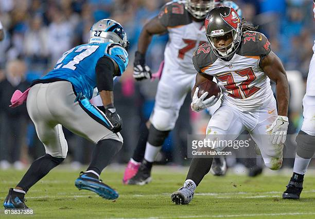 Jacquizz Rodgers of the Tampa Bay Buccaneers runs the ball against Robert McClain of the Carolina Panthers in the 1st quarter during the game at Bank...