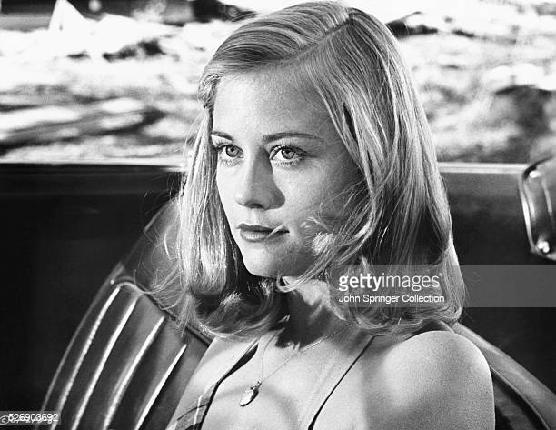 Jacy Farrow sits in the driver's seat of a car in a scene from the 1971 film The Last Picture Show