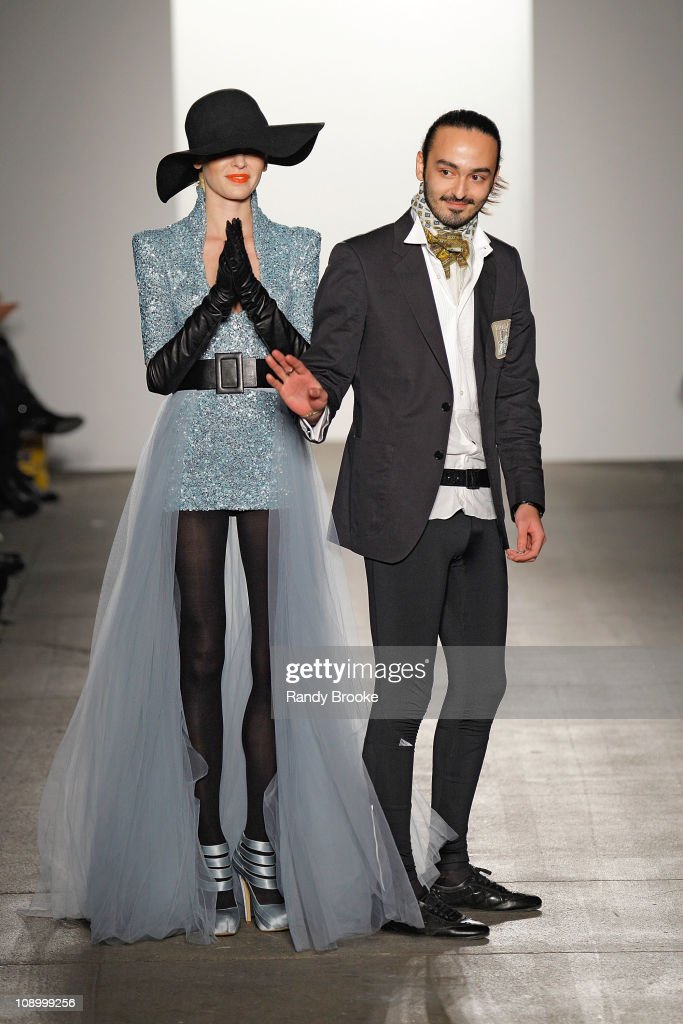 Jad Ghandour (R) walks the runway with a modael at the Jad Ghandour Fall 2011 fashion show during Mercedes-Benz Fashion Week at Exit Art on February 10, 2011 in New York City.
