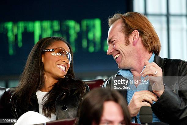 Jada Pinkett Smith and Hugo Weaving during a visit from the cast of 'The Matrix Reloaded' on MTV's Total Request Live May 13 2003 at the MTV Times...