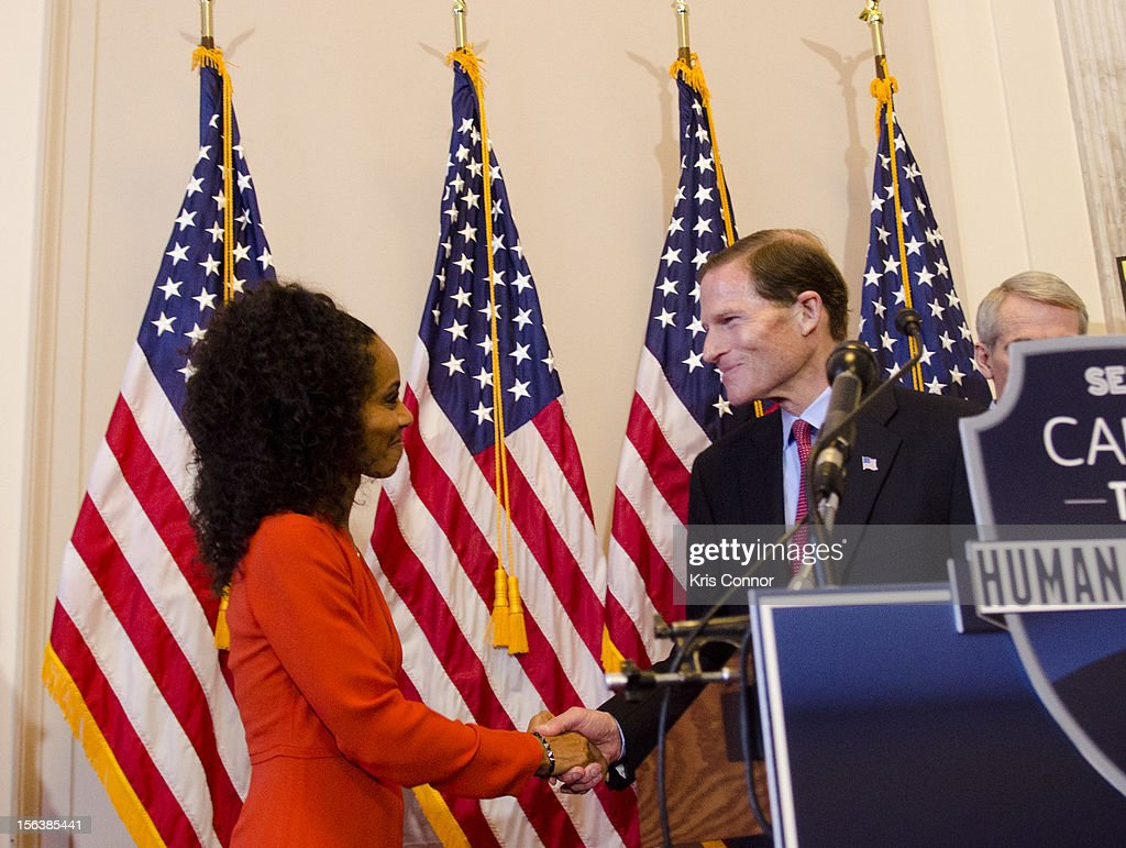 Jada Pinkett Smith and Richard Blumenthal shake hands during the launch of the Senate Caucus to End Human Trafficking at the Russell Senate Office Building on November 14, 2012 in Washington, DC.