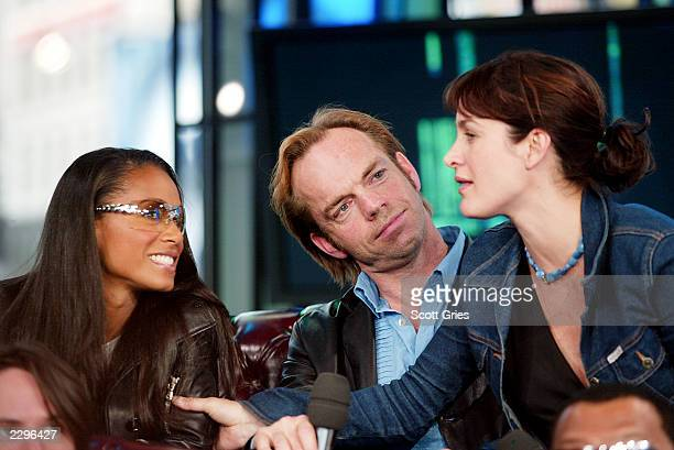 Jada Pinkett Smith Hugo Weaving and CarrieAnne Moss during a visit from the cast of 'The Matrix Reloaded' on MTV's Total Request Live May 13 2003 at...