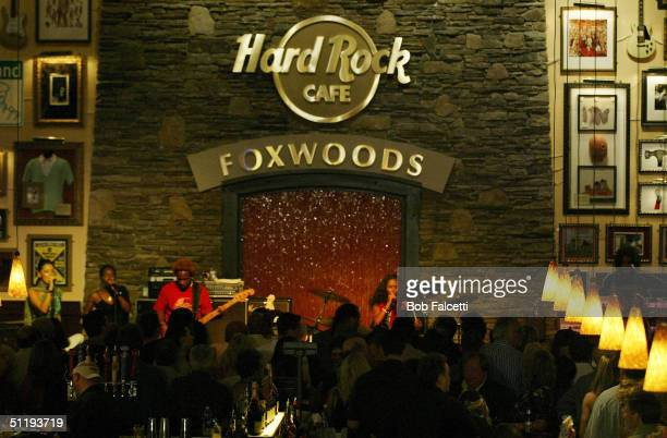 Jada Pinkett Smith performs at the grand opening of the Hard Rock Cafe at the Foxwoods Resort Casino August 19 2004 in Mashantucket Connecticut