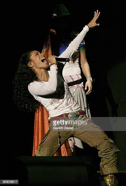 Jada Pinkett Smith wife of actor Will Smith and her band 'Wicked Wisdom' perform on stage supporting Britney Spears at the National Indoor Arena on...