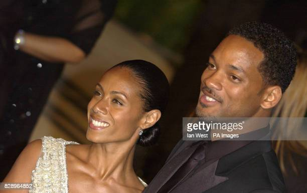 Jada PinkettSmith and husband Will Smith arrive at the Kodak Theatre in Los Angeles for the 76th Academy Awards Jada is wearing a dress by Valentino...