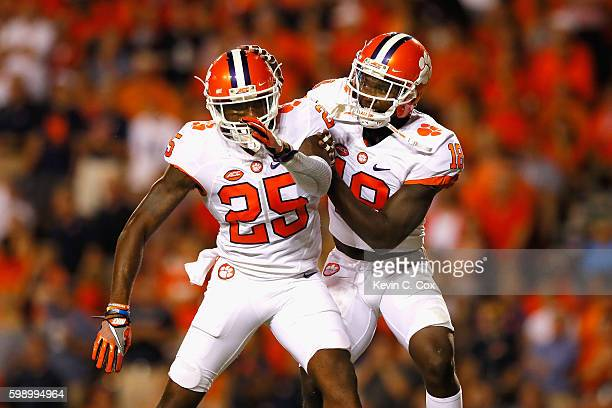 Jadar Johnson celebrates with Cordrea Tankersley of the Clemson Tigers after intercepting a pass during the second half against the Auburn Tigers at...