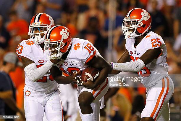 Jadar Johnson celebrates with Van Smith and Cordrea Tankersley of the Clemson Tigers after intercepting a pass during the second half against the...