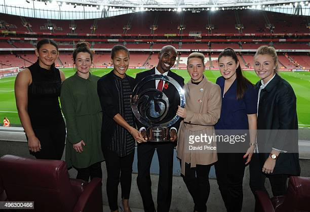 Jade Bailey Emma Mitchell Rachel Yankey Carla Humphrey and Leah Williamson of the Arsenal Ladies and Mo Farah with the Continental Cup Trophy before...