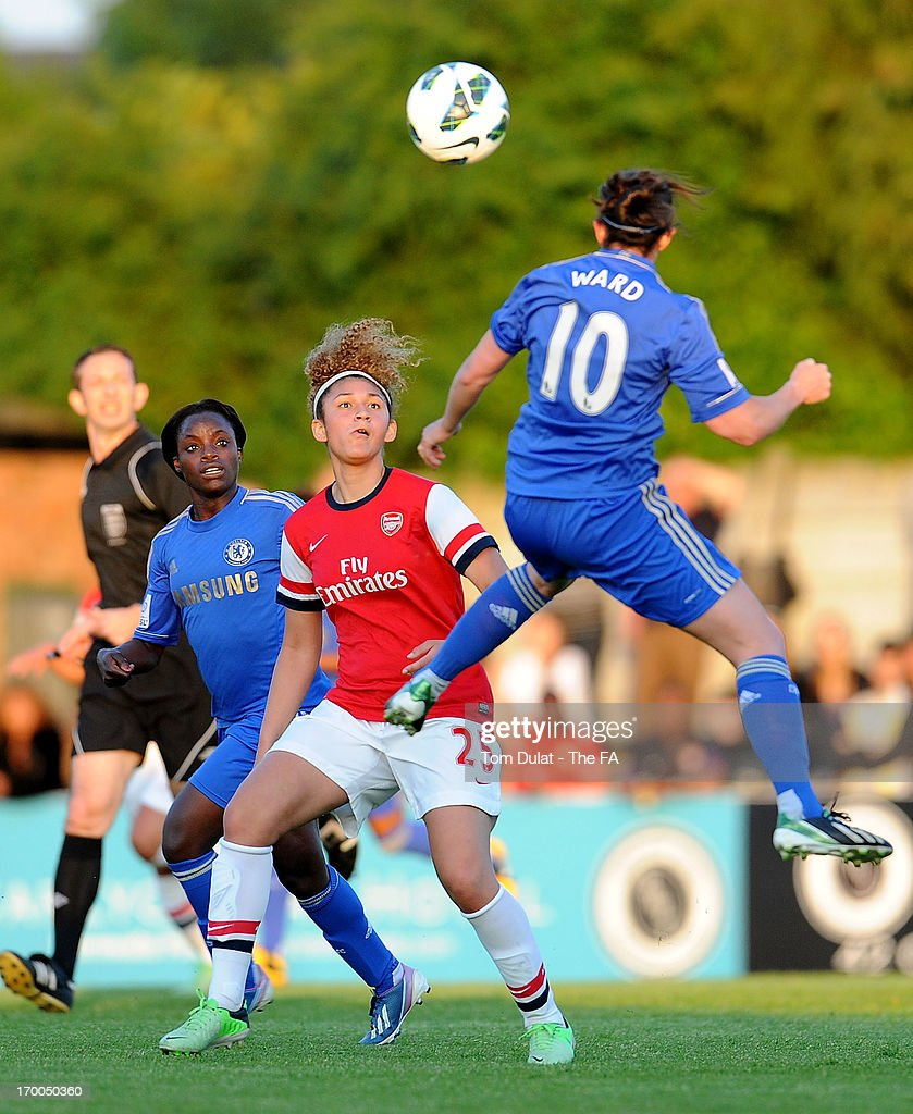 Jade Bailey of Arsenal Ladies FC and Eniola Aluko of Chelsea Ladies FC watch the ball during the FA WSL match between Arsenal Ladies FC and Chelsea Ladies FC at Meadow Park on June 06, 2013 in Borehamwood, England.