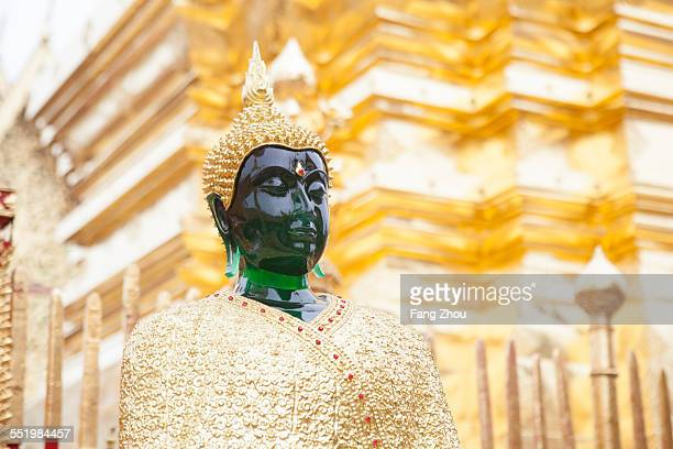 Jade buddha in front of golden temple, Chiang Mai, Thailand