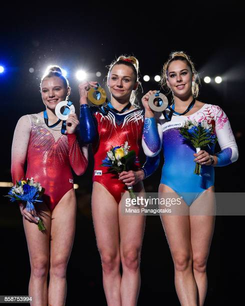 Jade Carey of The United States of America Maria Paseka of Russia and Giulia Steingruber of Switzerland hold up their medals after competing on the...