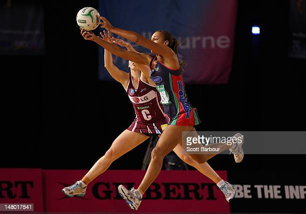 Jade Clarke of the Mystics and Geva Mentor of the Vixens compete for the ball during the Major Semi Final ANZ Championship match between the...