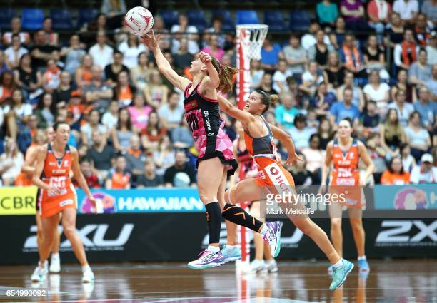 Jade Clarke of the Thunderbirds and Taylah Davies of the Giants contest possession during the round five Super Netball match between the Giants and...