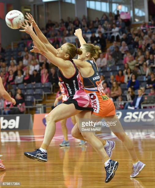 Jade Clarke of the Thunderbirds and Toni Anderson of the Giants during the round eleven Super Netball match between the Thunderbirds and the Giants...