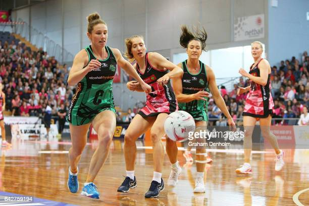 Jade Clarke of the Thunderbirds is surrounded by the Fever defense during the round one Super Netball match between the Thunderbirds and Fever on...
