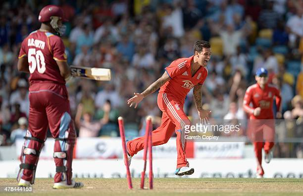 Jade Dernbach of England celebrates dismissing Dwayne Smith of the West Indies during the 3rd T20 International match between the West Indies and...