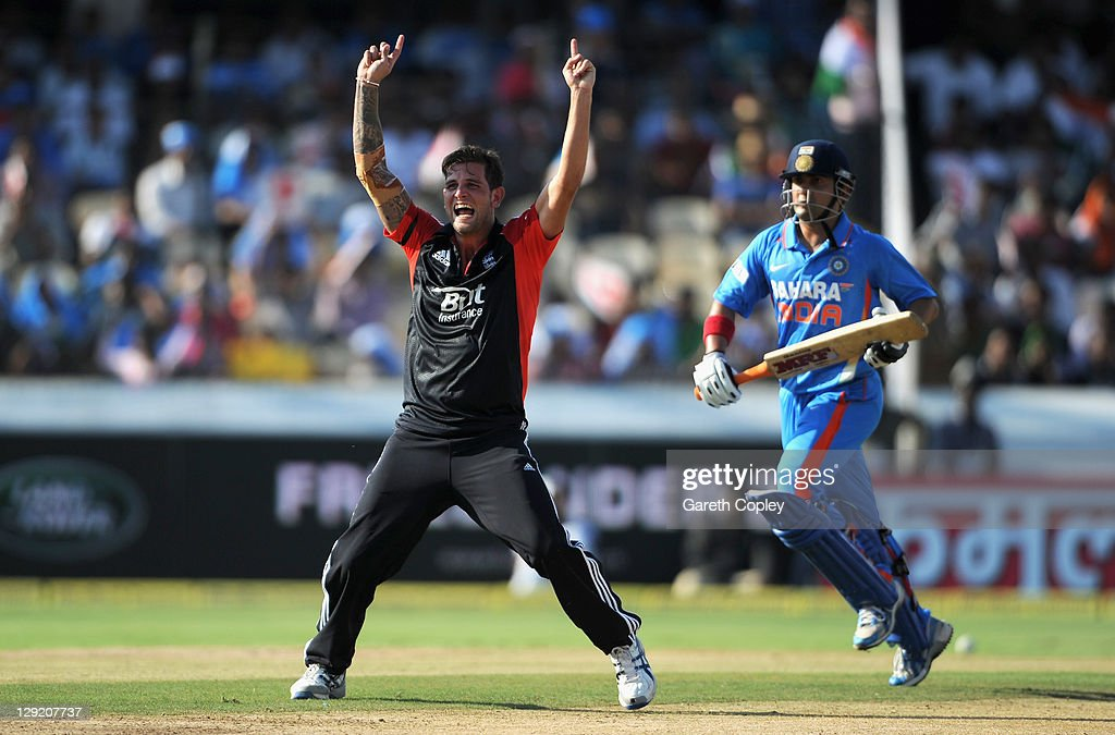 Jade Dernbach of England celebrates dismissing <a gi-track='captionPersonalityLinkClicked' href=/galleries/search?phrase=Gautam+Gambhir&family=editorial&specificpeople=707703 ng-click='$event.stopPropagation()'>Gautam Gambhir</a> of India during the 1st One Day International between England and India at The Rajiv Gandhi International Cricket Stadium on October 14, 2011 in Hyderabad, India.