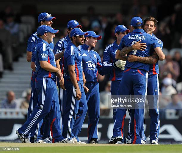Jade Dernbach of England celebrtes taking the wicket of Dean Elgar of South Africa with his team mates during the 3rd NatWest Series ODI between...