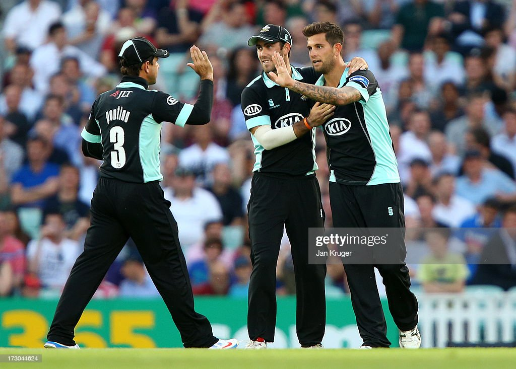 <a gi-track='captionPersonalityLinkClicked' href=/galleries/search?phrase=Jade+Dernbach&family=editorial&specificpeople=667885 ng-click='$event.stopPropagation()'>Jade Dernbach</a> of Surrey celebrates a wicket with <a gi-track='captionPersonalityLinkClicked' href=/galleries/search?phrase=Ricky+Ponting&family=editorial&specificpeople=176564 ng-click='$event.stopPropagation()'>Ricky Ponting</a> and Glen Maxwell during the Friends Life T20 match between Surrey Lions and Middlesex Panthers at The Kia Oval on July 5, 2013 in London, England.