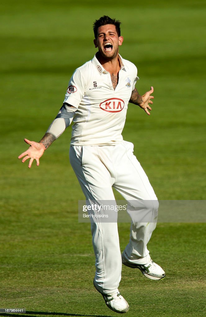 <a gi-track='captionPersonalityLinkClicked' href=/galleries/search?phrase=Jade+Dernbach&family=editorial&specificpeople=667885 ng-click='$event.stopPropagation()'>Jade Dernbach</a> of Surrey celebrates after taking the wicket of Paul Stirling of Middlesex during the LV County Championship match between Middlesex and Surrey at Lords on May 03, 2013 in London, England.