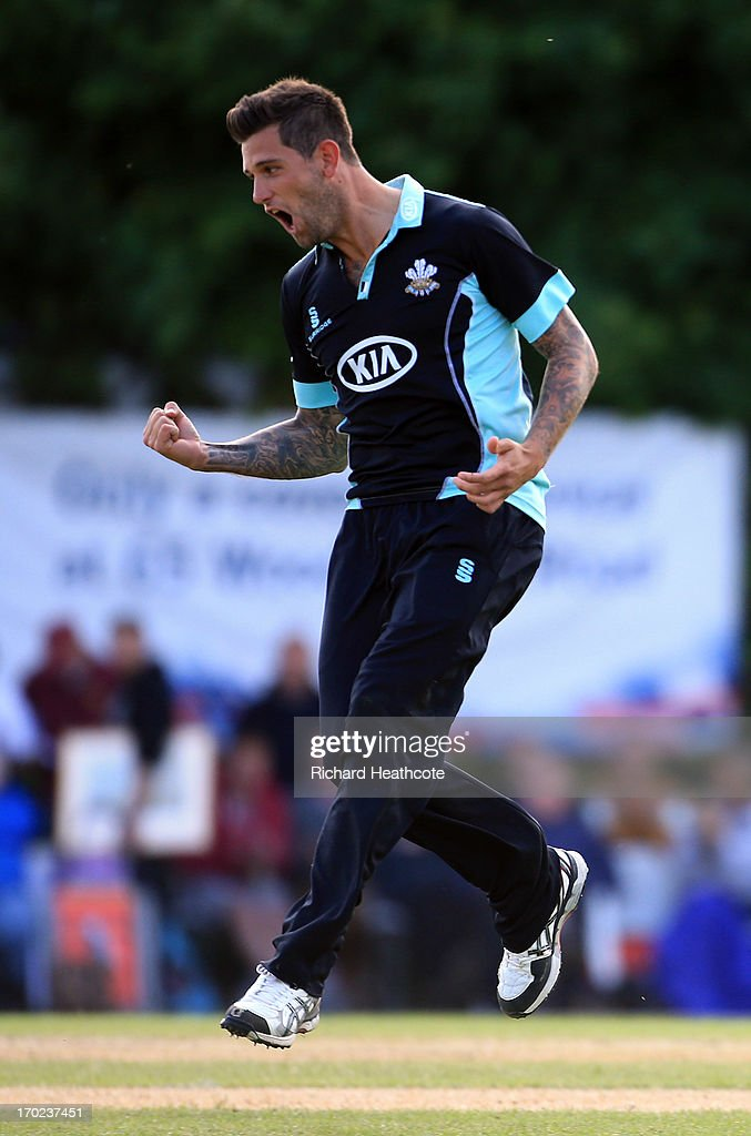 <a gi-track='captionPersonalityLinkClicked' href=/galleries/search?phrase=Jade+Dernbach&family=editorial&specificpeople=667885 ng-click='$event.stopPropagation()'>Jade Dernbach</a> of Surrey celebrates taking the wicket of Steven Croft during the Yorkshire Bank 40 match between Surrey and Lancashire at Guildford Cricket Club on June 9, 2013 in Guildford, England.